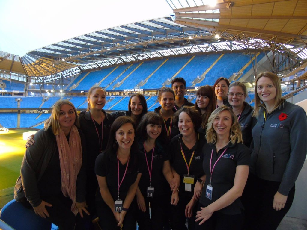 The Speech Bubble Team Members in a Stadium, Smiling